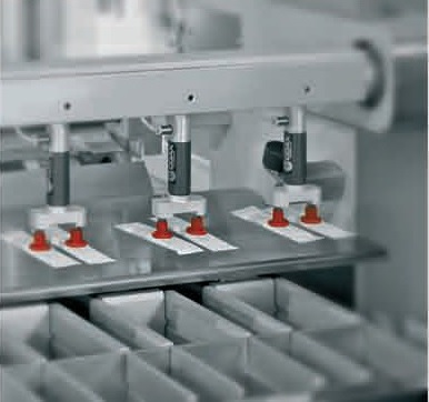 packaging machine for liquids: stick pick-up system